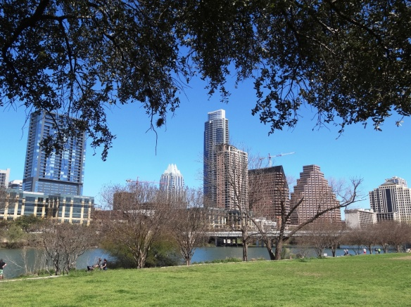 Looking at downtown across Town Lake, from a shady spot in Auditorium Shores.